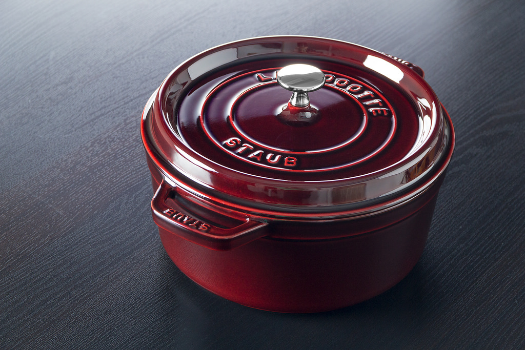 A red Staub Dutch oven