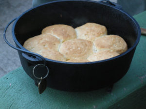 Biscuits baking in a bare cast-iron Dutch oven