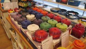 A store display of Le Creuset Dutch ovens