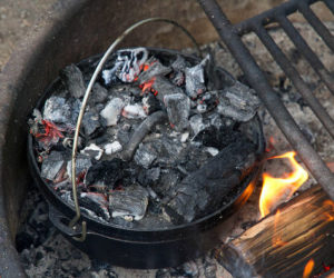 Camp Dutch oven topped with coals