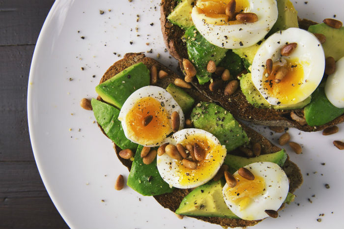Boiled eggs and avocado on whole grain toast