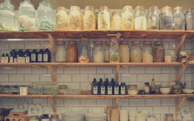 Kitchen shelves filled with bottles and jars of food items